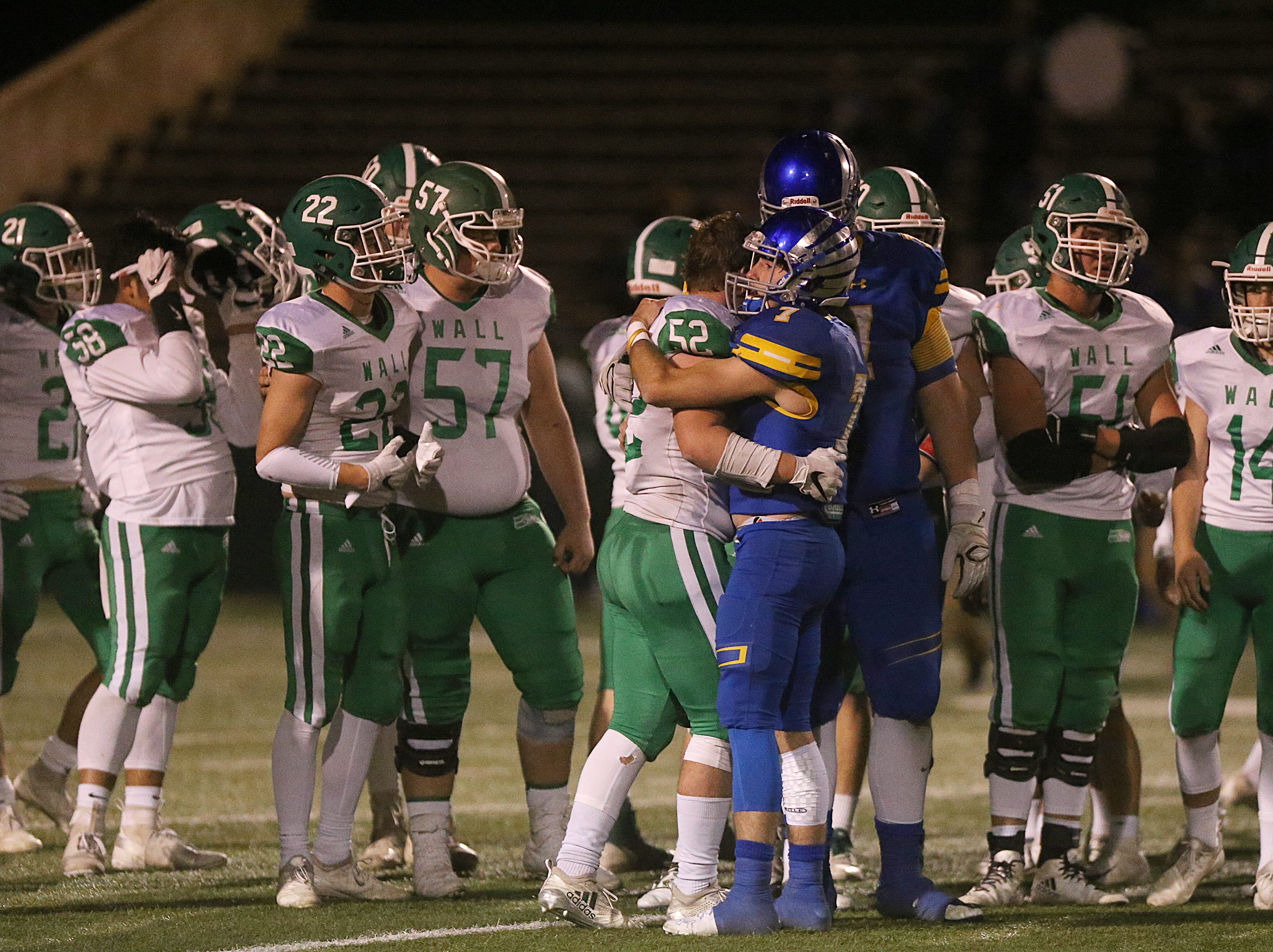 Wall and Brock players embrace after the game Friday, Nov. 30, 2018, at Shotwell Stadium in Abilene. Wall lost 13 to 35.
