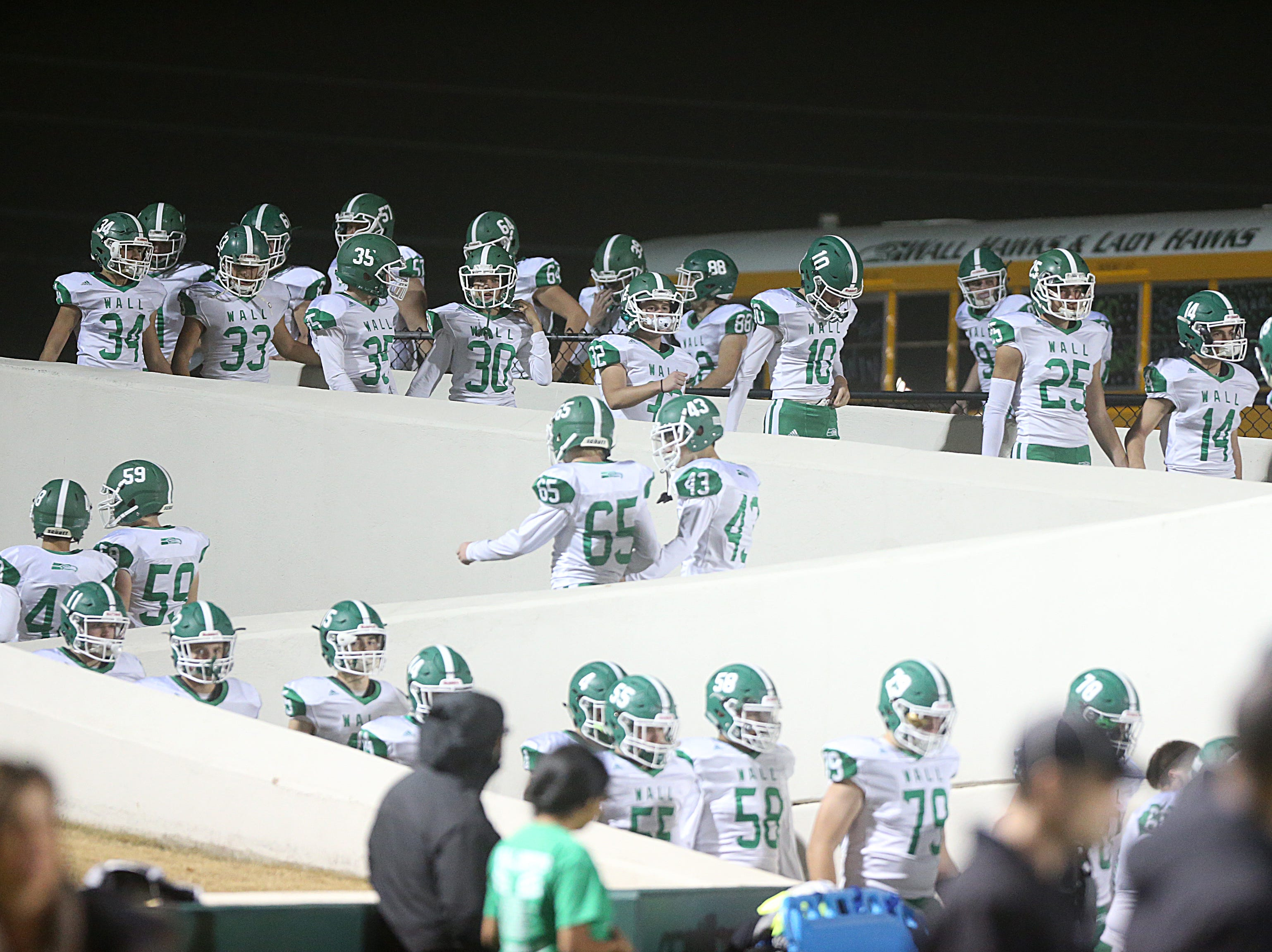 The Wall Hawks make their way to the field Friday, Nov. 30, 2018, during their game against the Brock Eagles at Shotwell Stadium in Abilene. Wall lost 13 to 35.