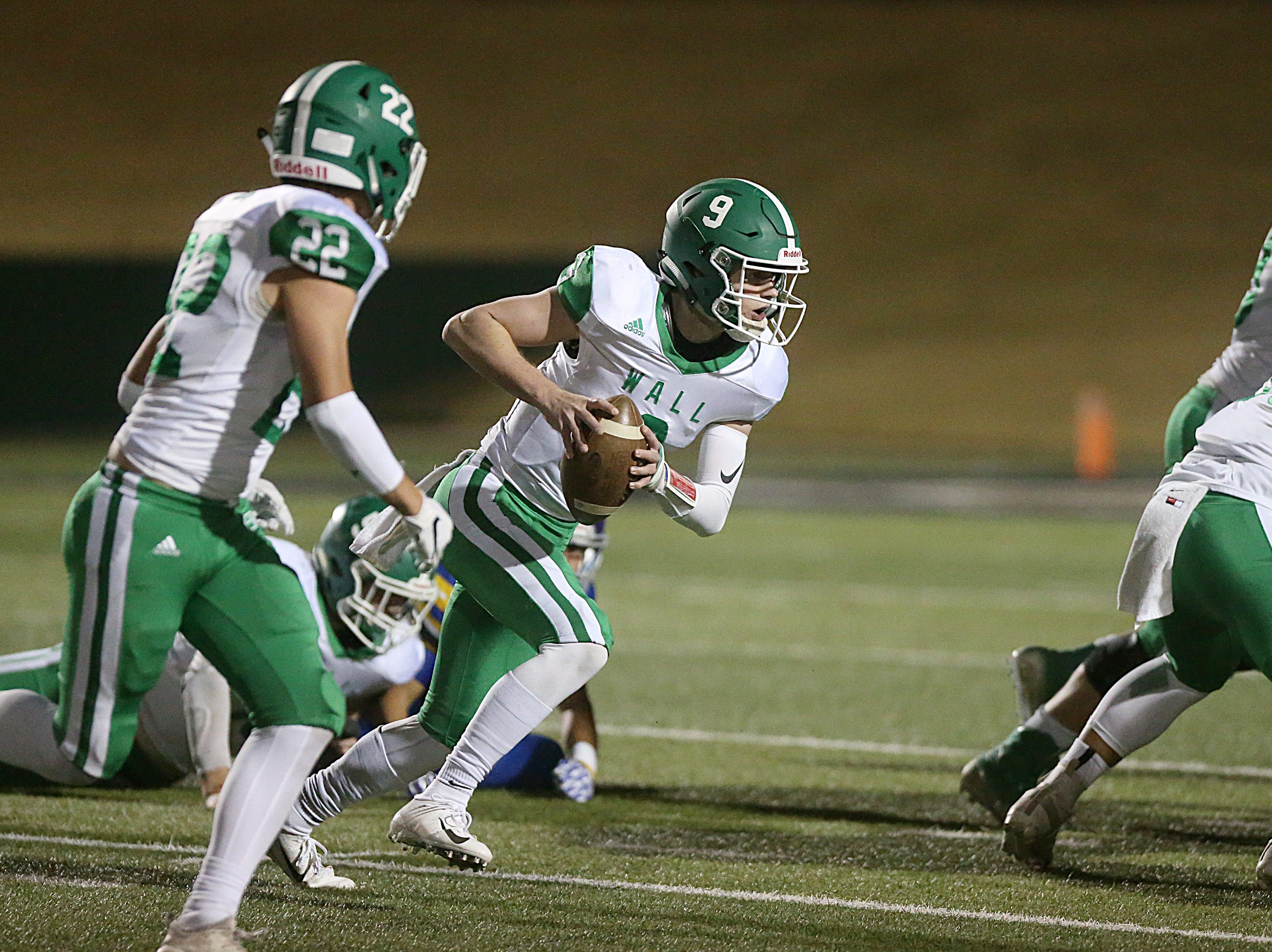 Wall's Mason Fuchs (#9) makes a play downfield Friday, Nov. 30, 2018, during their game against the Brock Eagle at Shotwell Stadium in Abilene. Wall lost 13 to 35.