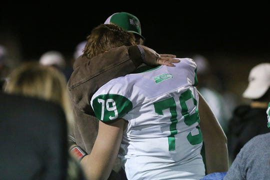 Wall's Tate Williams (#79) is comforted by a loved one Friday, Nov. 30, 2018, after their teams loss to the Brock Eagles at Shotwell Stadium in Abilene. Wall lost 13 to 35.