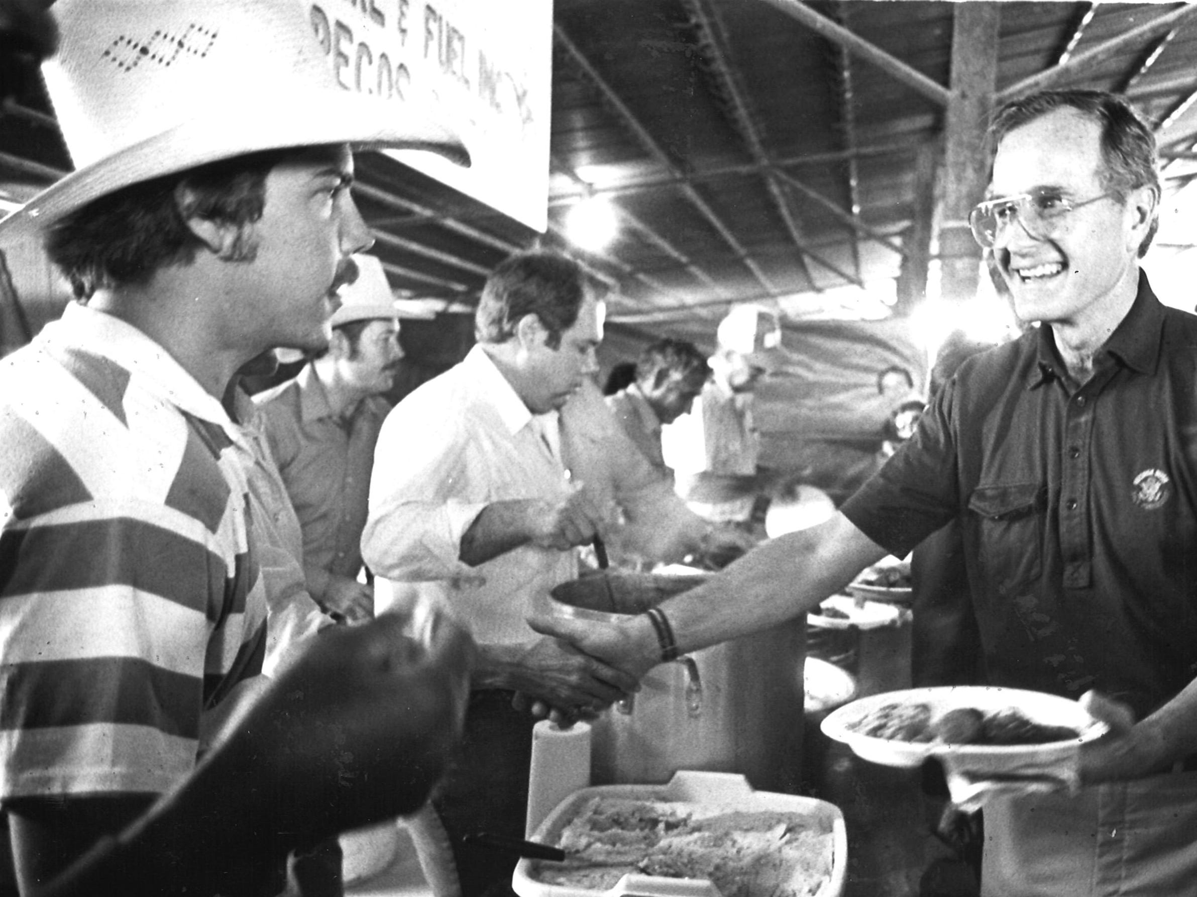 Vice President George Bush shakes hands with participants at a barbecue on Oct. 16, 1982 in Pecos.