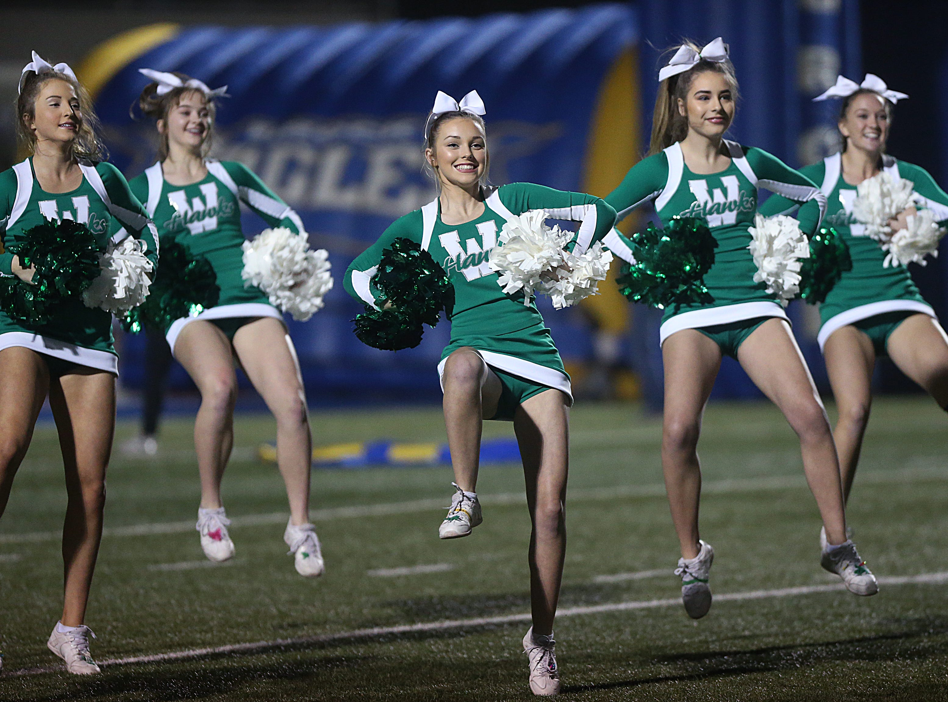 Wall cheerleaders perform for the crowd Friday, Nov. 30, 2018, before the start of the game between the Wall Hawks and the Brock Eagles at Shotwell Stadium in Abilene. Wall lost 13 to 35.