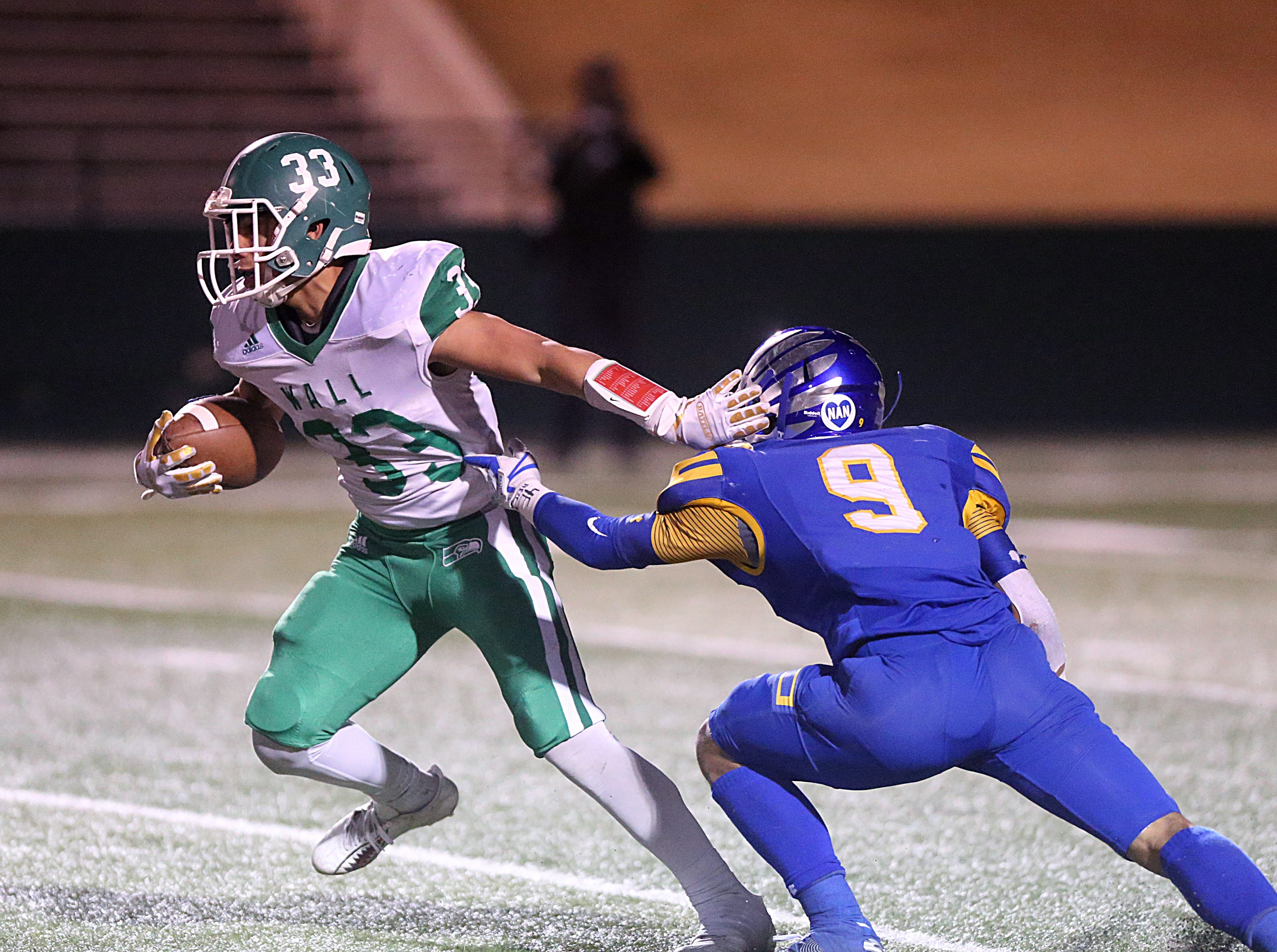 Wall's Chase Rios (#33) pushes past Brock's Kaden Hendrix (#9) Friday, Nov. 30, 2018, during their game at Shotwell Stadium in Abilene. Wall lost 13 to 35.