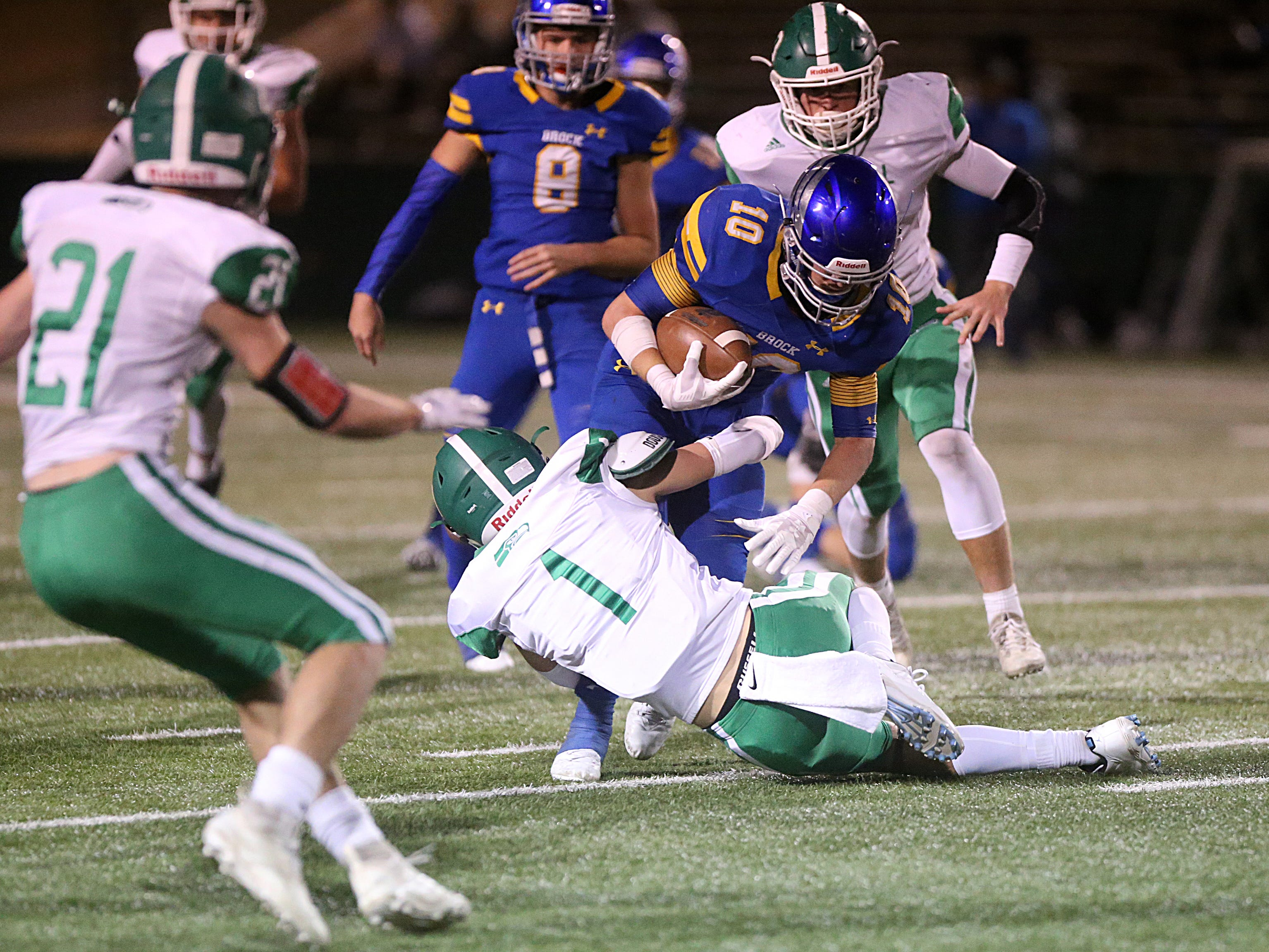 Brock's Toby Morrison (#10) is tackled by Wall's Cameron Barnes (#1) Friday, Nov. 30, 2018, during their game at Shotwell Stadium in Abilene. Wall lost 13 to 35.