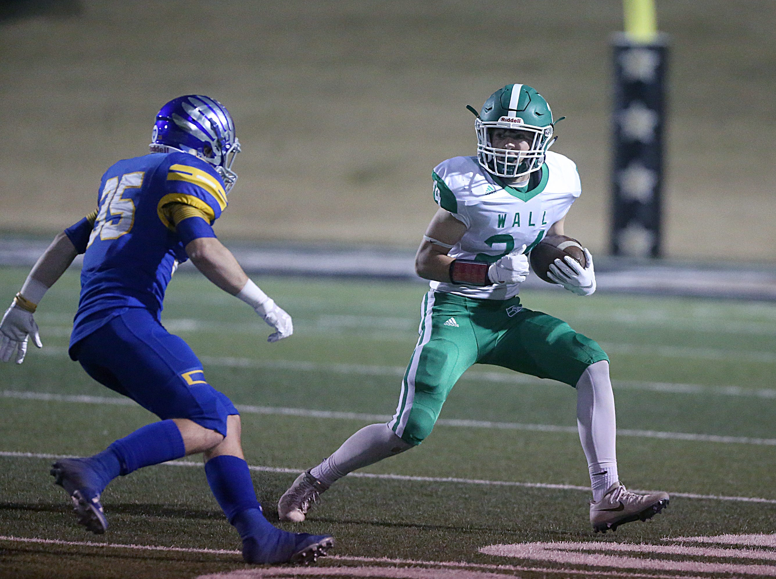 Wall's Kye Herbert (#24) tries to rush past Brock's Landon Hoffman (#35) Friday, Nov. 30, 2018, at Shotwell Stadium in Abilene.