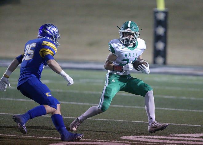 Wall's Kye Herbert (#24) tries to rush past Brock's Landon Hoffman (#35) Friday, Nov. 30, 2018, at Shotwell Stadium in Abilene.
