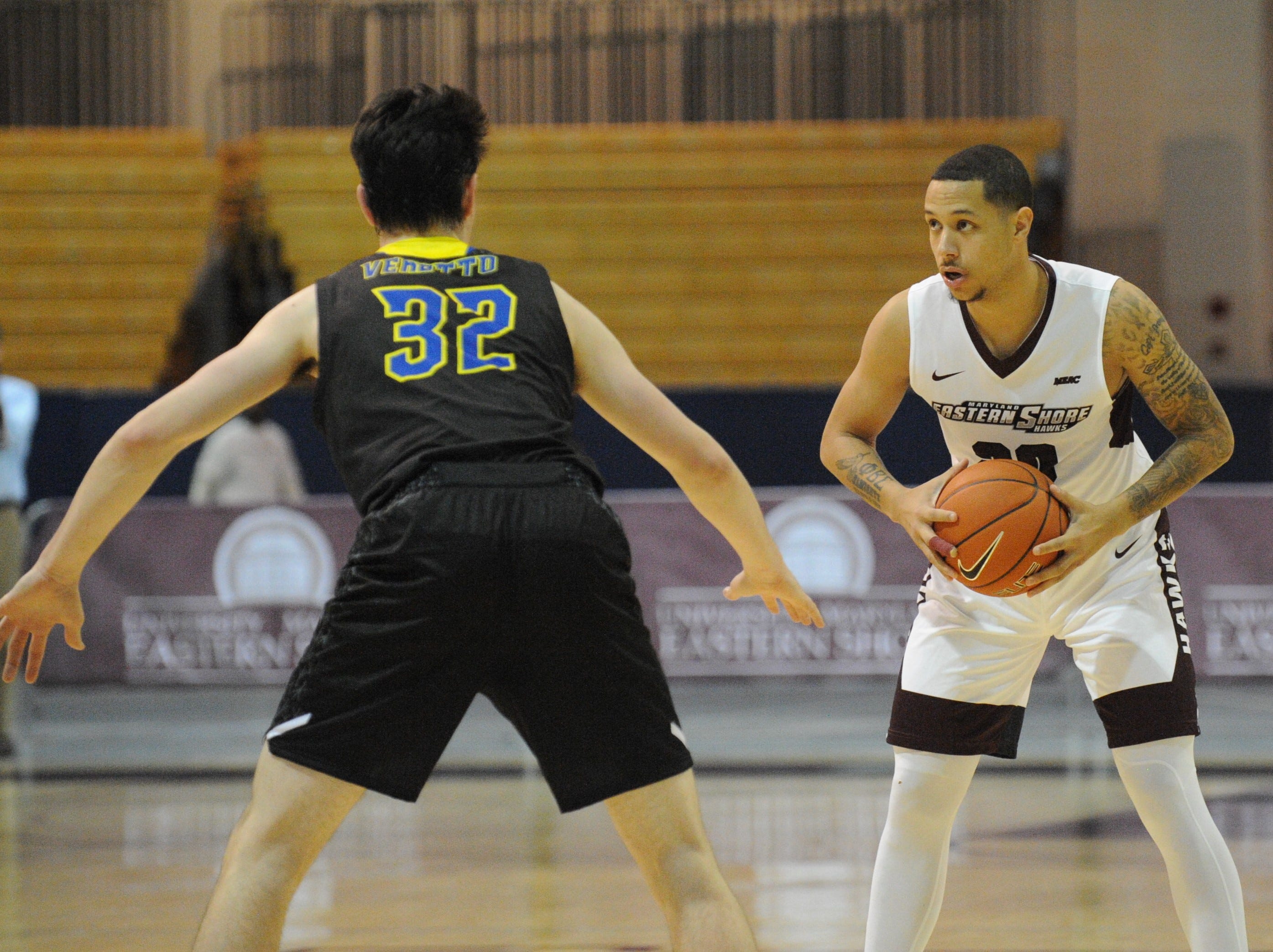 University of Maryland Eastern Shore guard Dontae Caldwell looks to pass against the University of Delaware on Friday, Nov. 30, 2018. The Blue Hens beat the Hawks, 71-62.