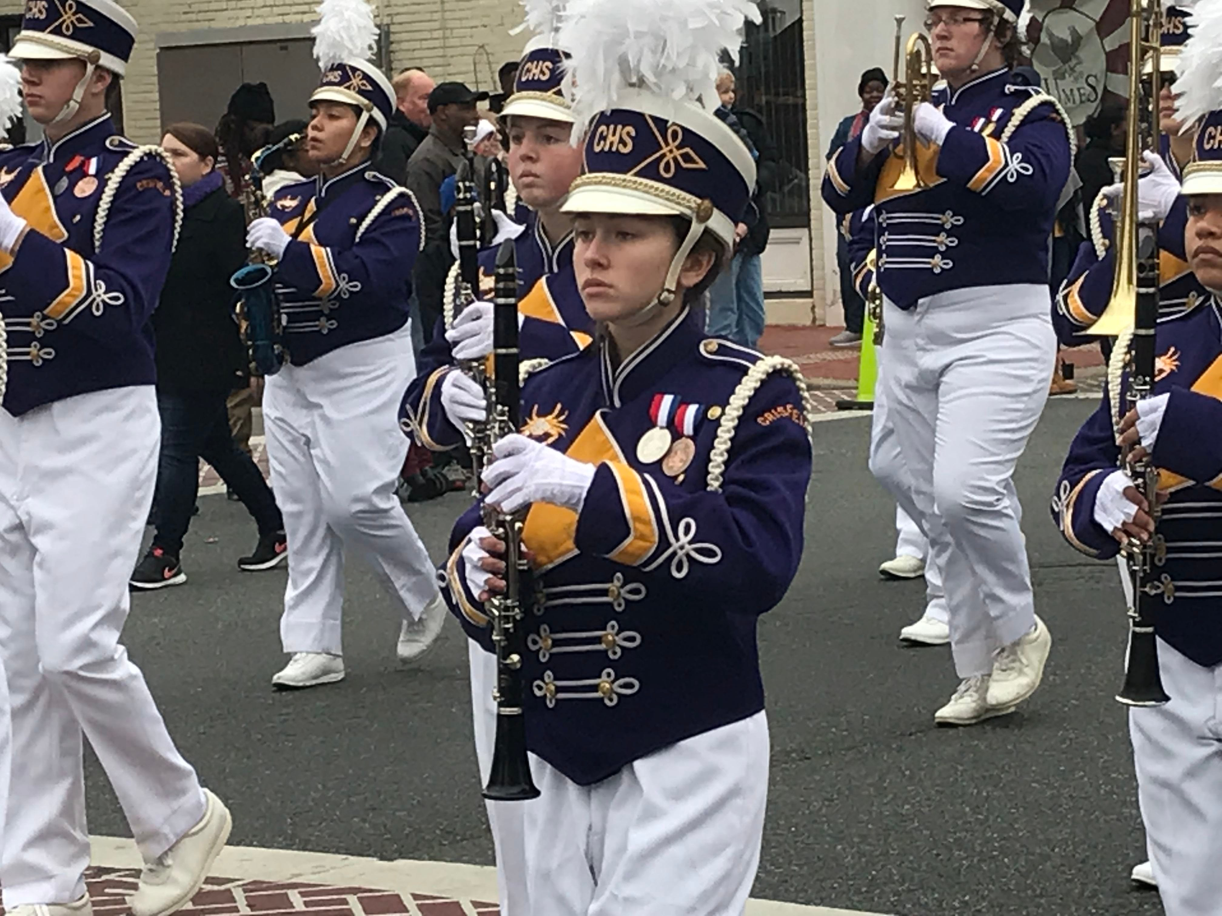 Members of the Crisfield High School Marching Band march.