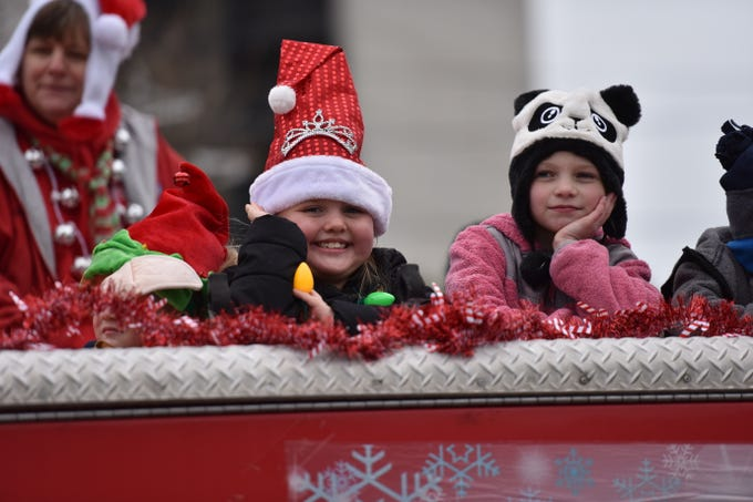 Kids riding on top of fire truck wave to the viewers at the Ocean City Chrsitmas parade on Saturday, Dec. 1, 2018.