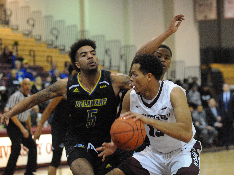 University of Maryland Eastern Shore forward Tyler Jones goes against University of Delaware forward Eric Carter on Friday, Nov. 30, 2018. The Blue Hens beat the Hawks, 71-62.