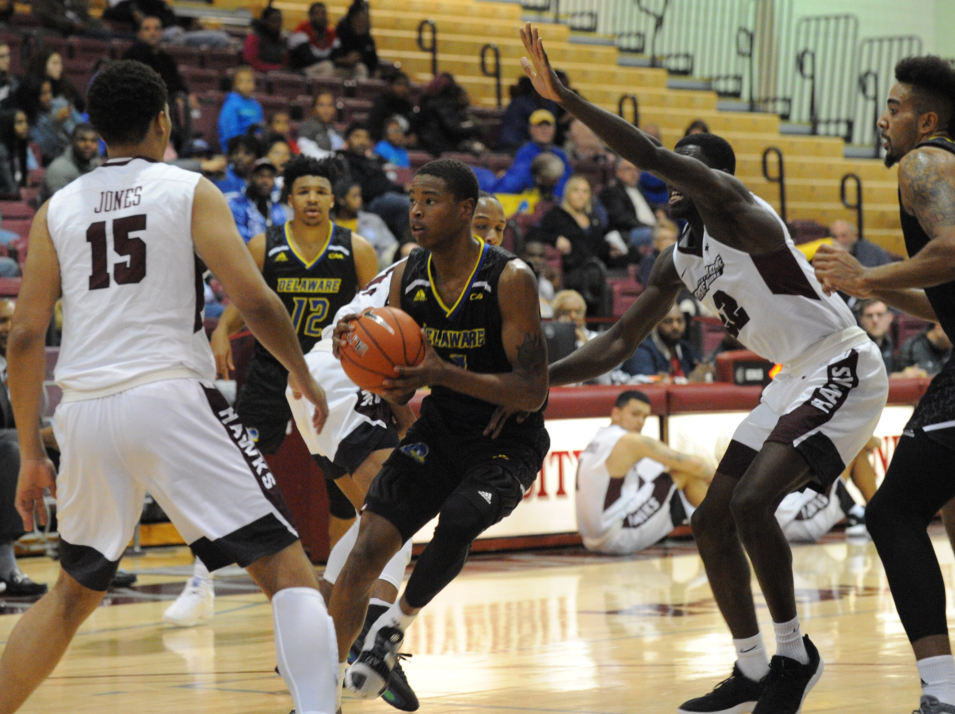 University of Delaware guard Kevin Anderson dribbles between traffic against the University of Maryland Eastern Shore on Friday, Nov. 30, 2018. The Blue Hens beat the Hawks, 71-62.