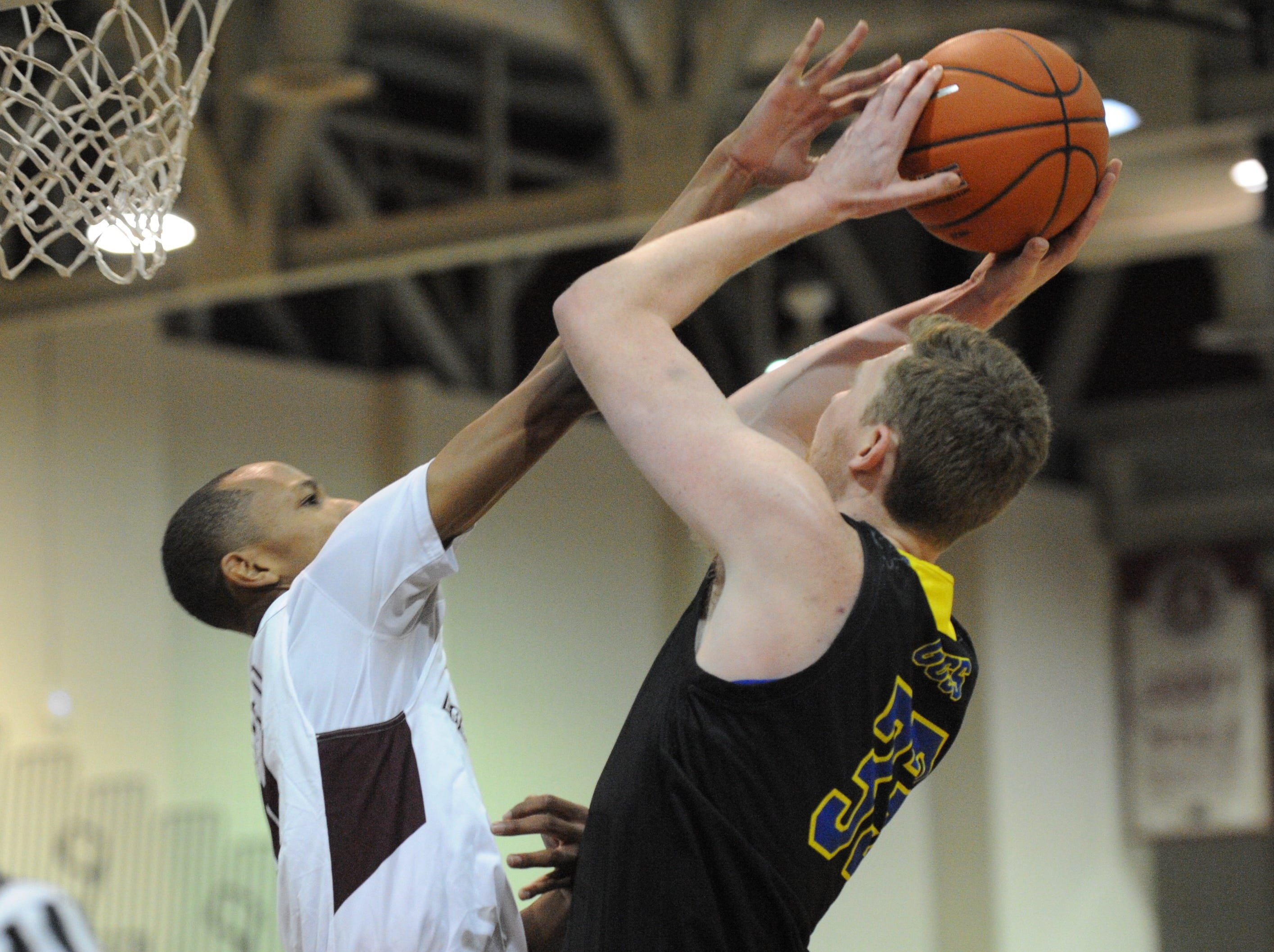 University of Delaware forward Collin Goss gets a shot blocked by University of Maryland Eastern Shore guard Montraz Oliver on Friday, Nov. 30, 2018. The Blue Hens beat the Hawks, 71-62.