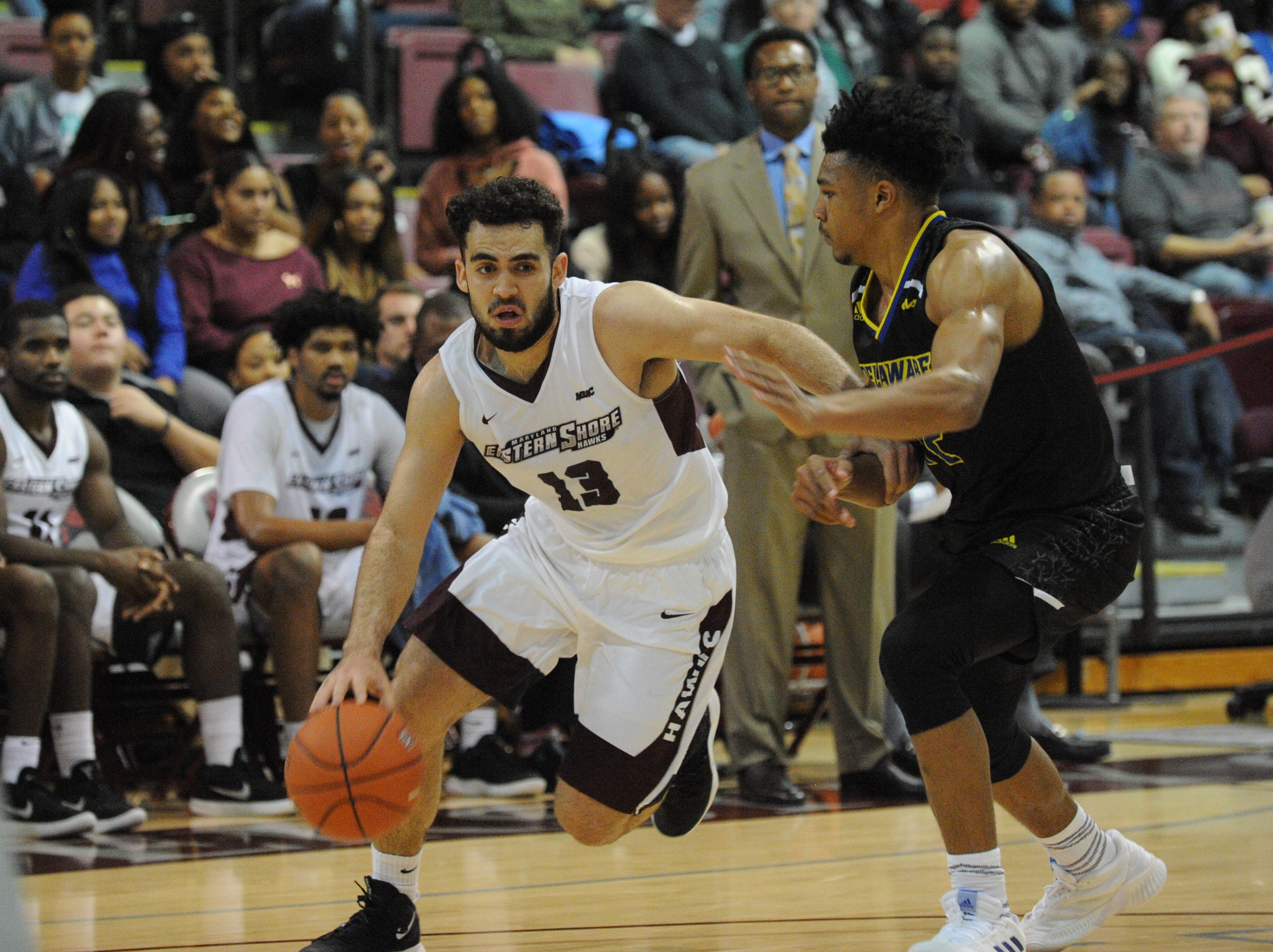 University of Maryland Eastern Shore guard Bryan Urrutia dribbles down the lane against the University of Delaware on Friday, Nov. 30, 2018. The Blue Hens beat the Hawks, 71-62.