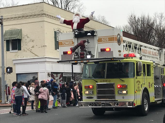 Santa greeted parade-goers from the last firetruck in the parade.