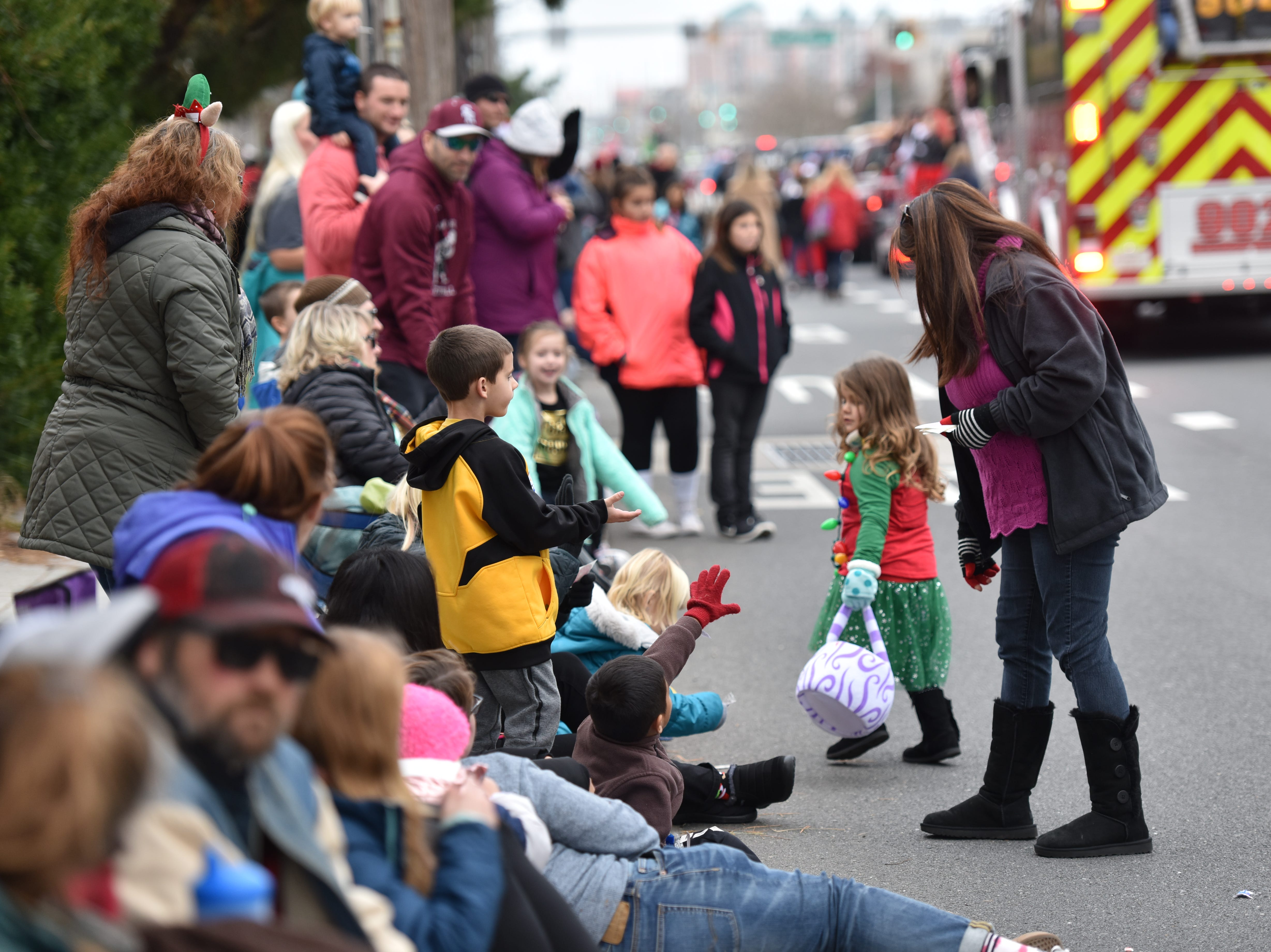 Kids got candy and freebies at the Ocean City Chrsitmas parade on Saturday, Dec. 1, 2018.