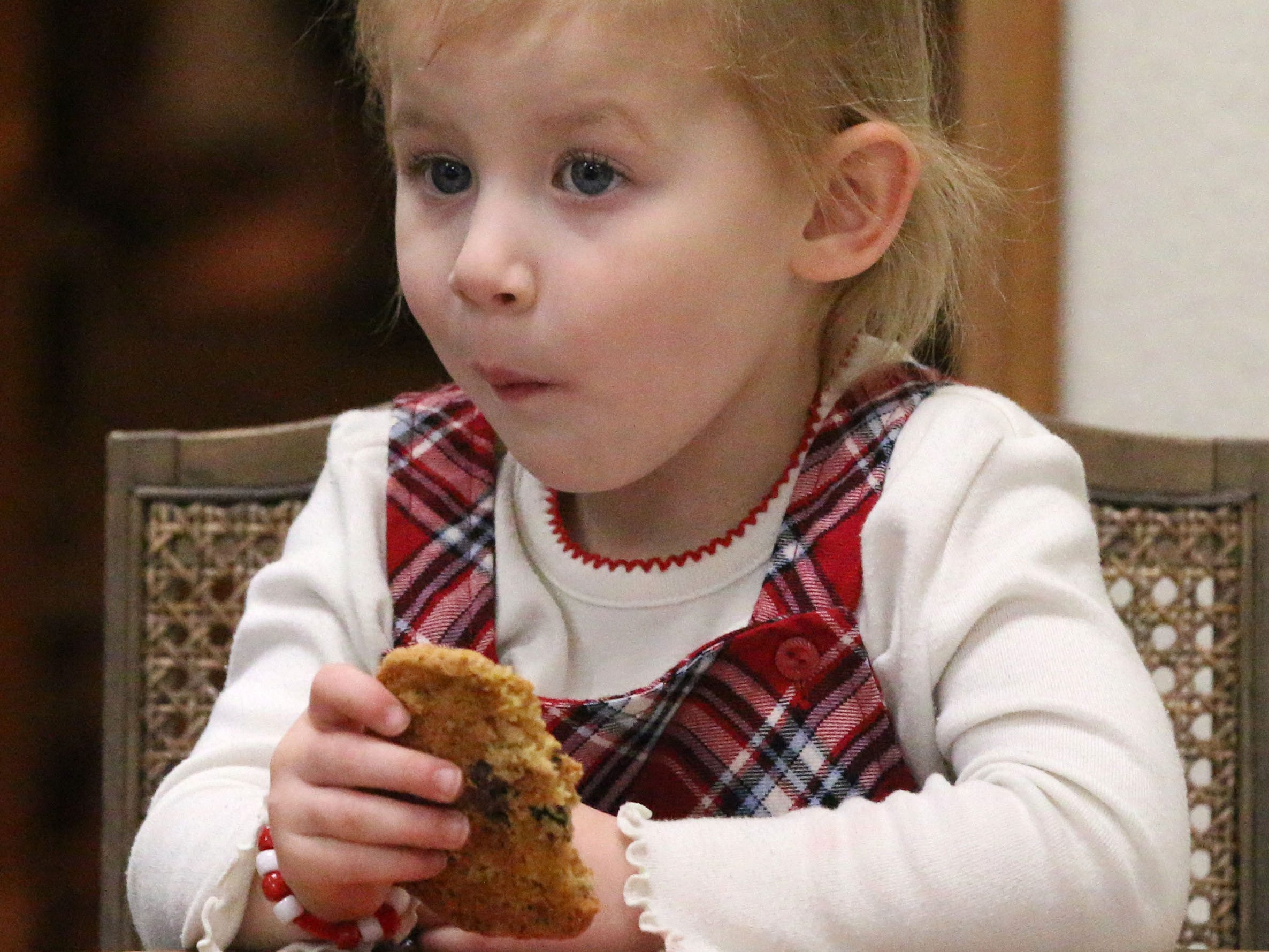 Kadence Baumhardt, 3, of Howards Grove, munches on a cookie during Cookies with Santa at Zimmer Westview Funeral and Cremation Care Center Saturday, December 1, 2018, in Howards Grove, Wis.  The firm also plans to have Santa at Ballhorn Chapels on December 8, 2018.