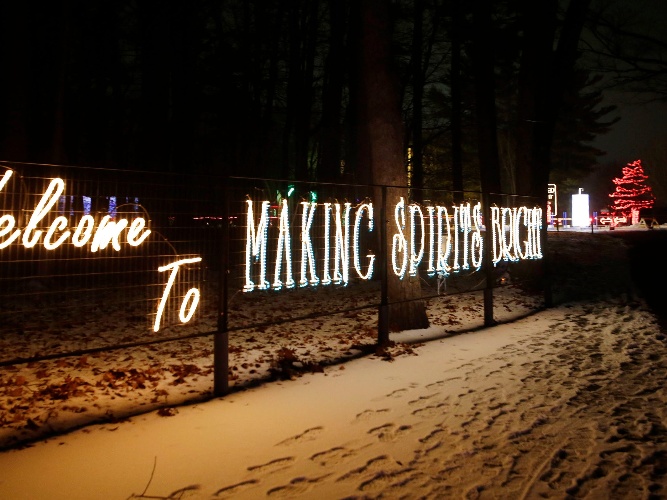 People are welcomed at a sign at Making Spirits Bright at Evergreen Park, Friday, November 30, 2018, in Sheboygan, Wis.