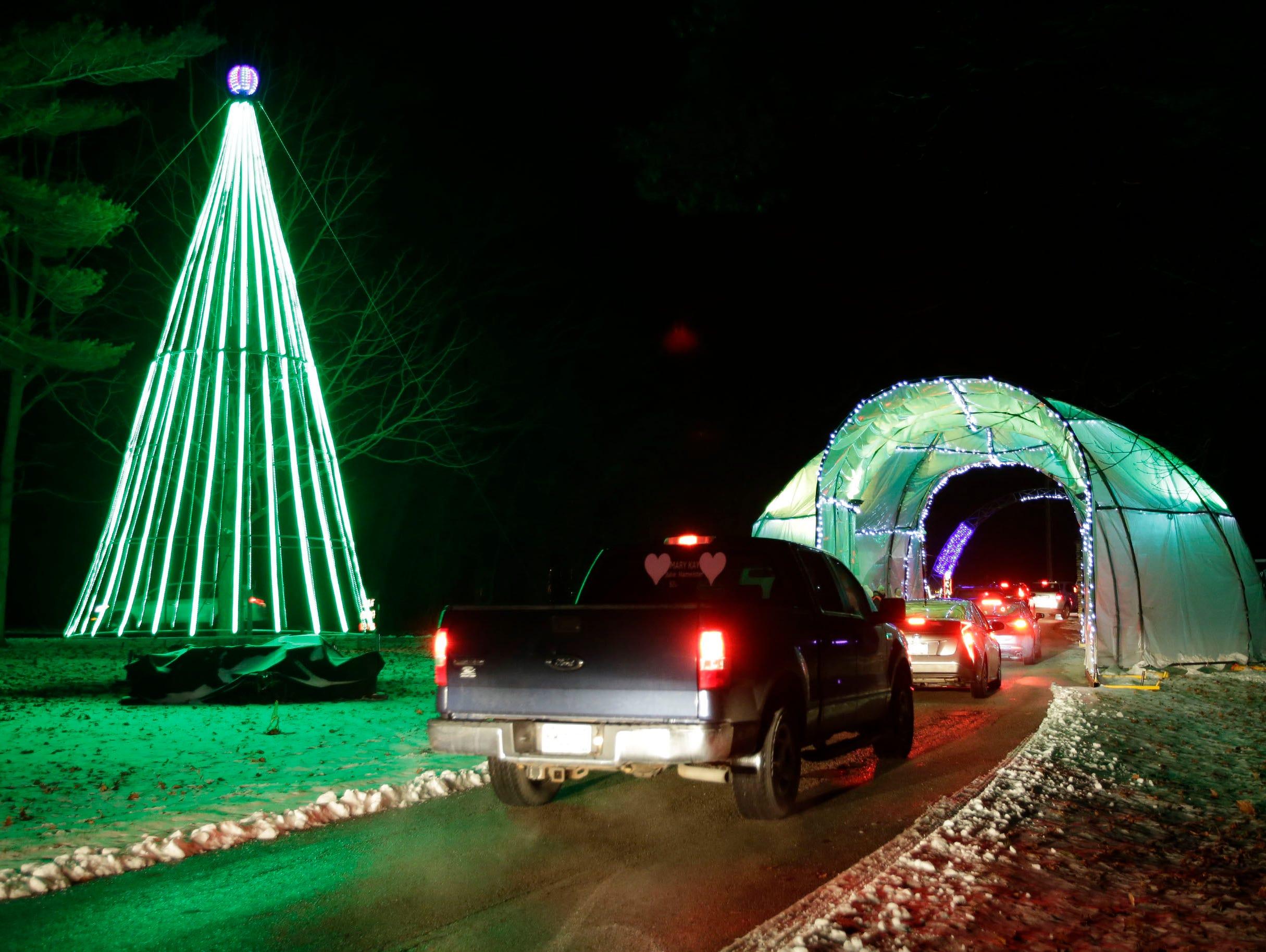 Vehicles exit Making Spirits Bright at Evergreen Park, Friday, November 30, 2018, in Sheboygan, Wis.