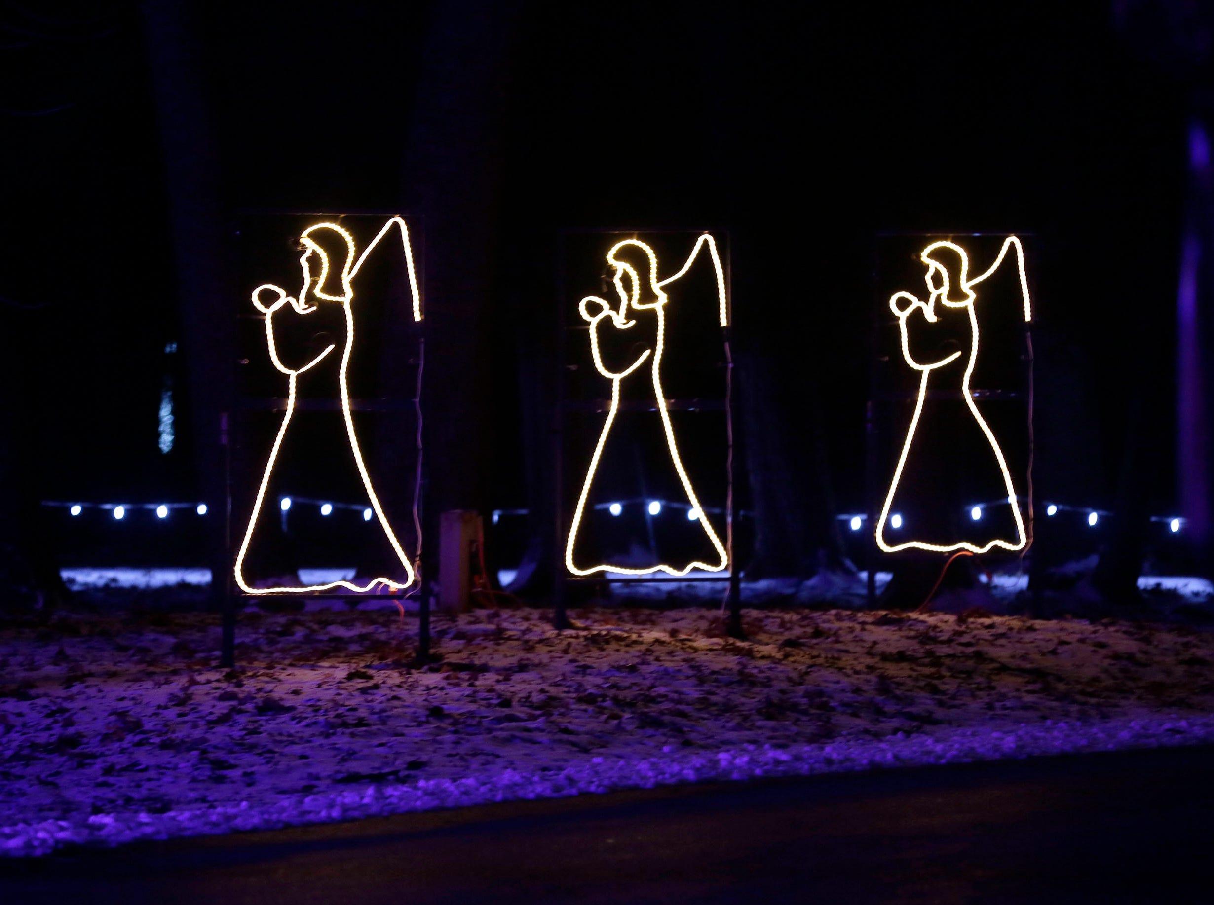 Angels in a row at Making Spirits Bright at Evergreen Park, Friday, November 30, 2018, in Sheboygan, Wis.
