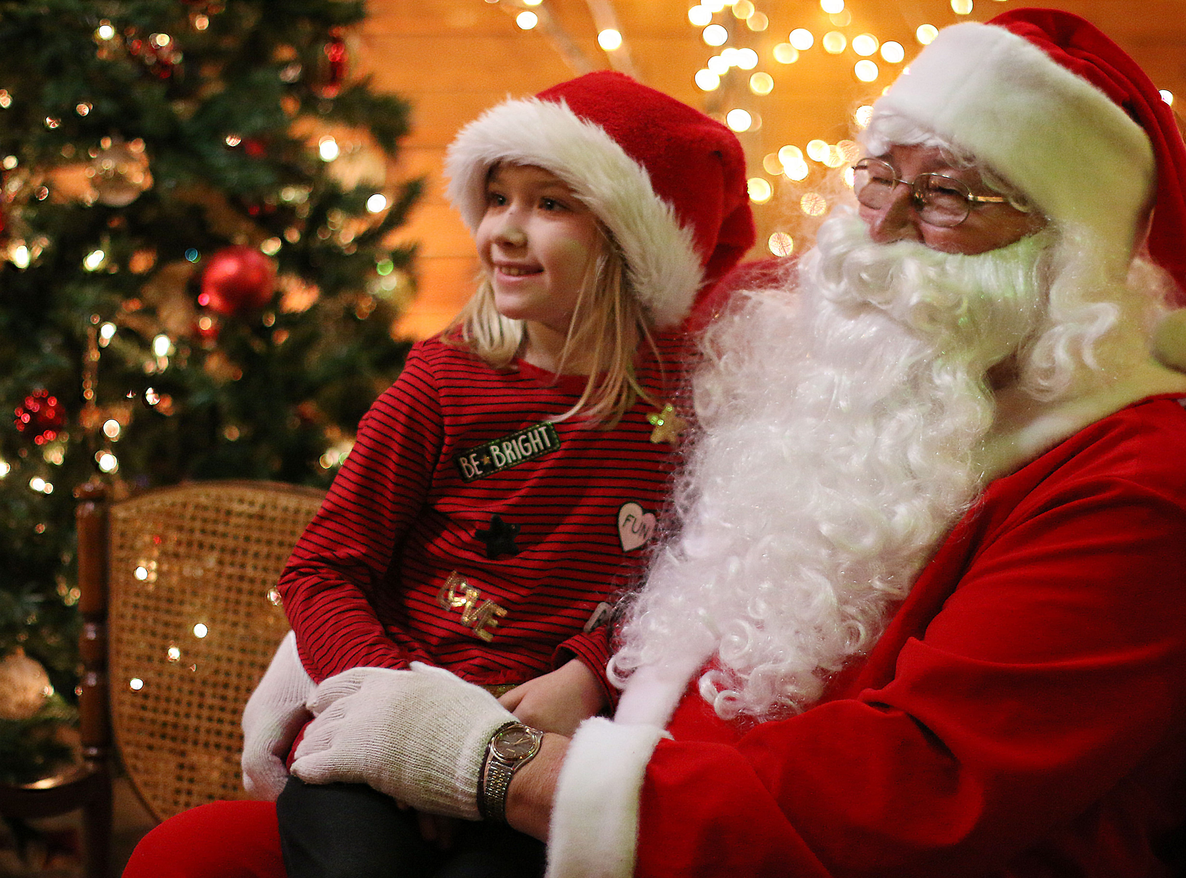 Paisyn Larzelere, 6, of Manitowoc, Wis., poses with Santa Clause at the Quarryview Center for Making Spirits Bright, Friday, November 30, 2018, in Sheboygan, Wis.