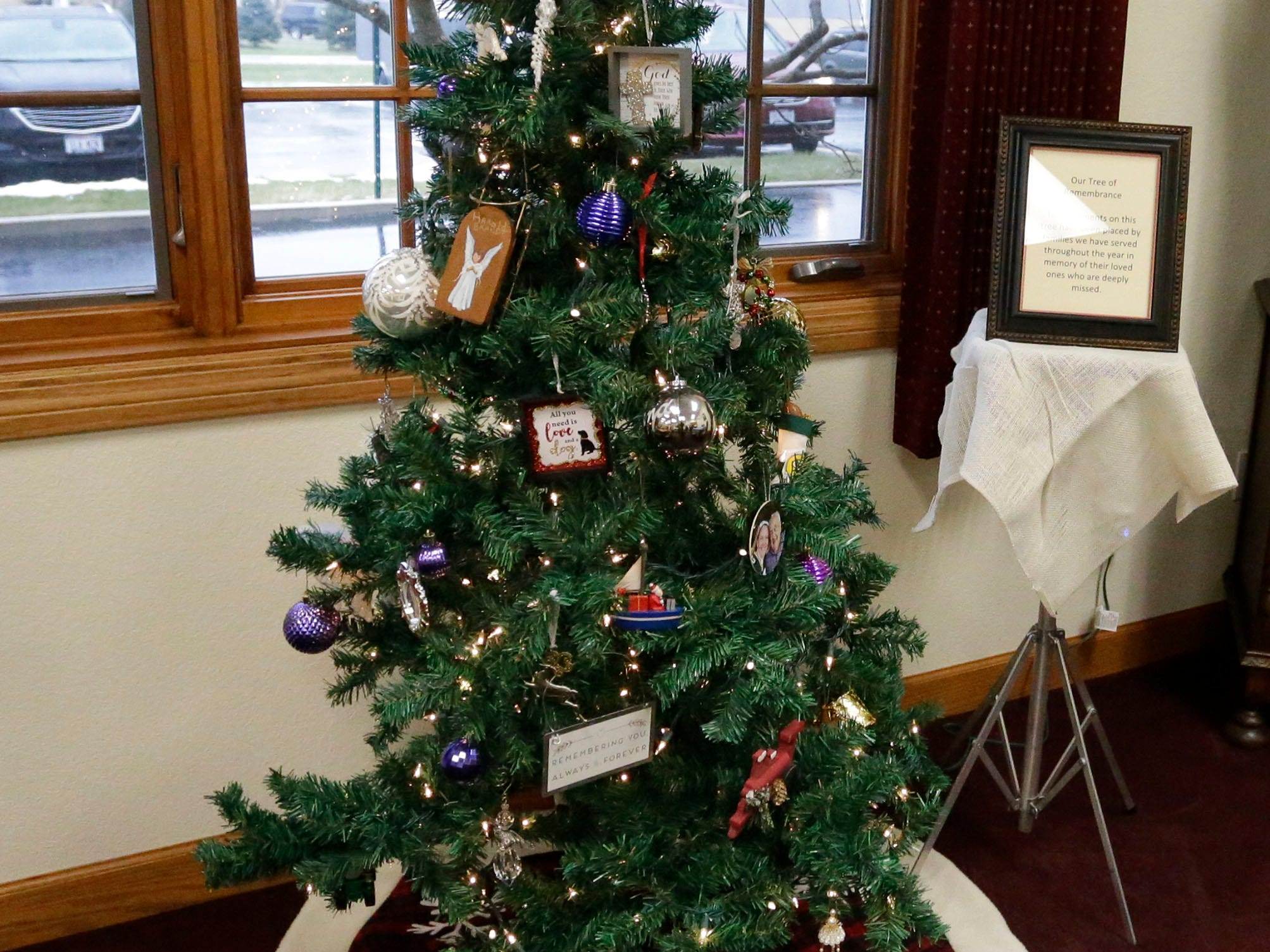 A special holiday tree honoring people who have passed away in the last year during Cookies with Santa at Zimmer Westview Funeral and Cremation Care Center Saturday, December 1, 2018, in Howards Grove, Wis. The firm also plans to have Santa at Ballhorn Chapels on December 8, 2018.
