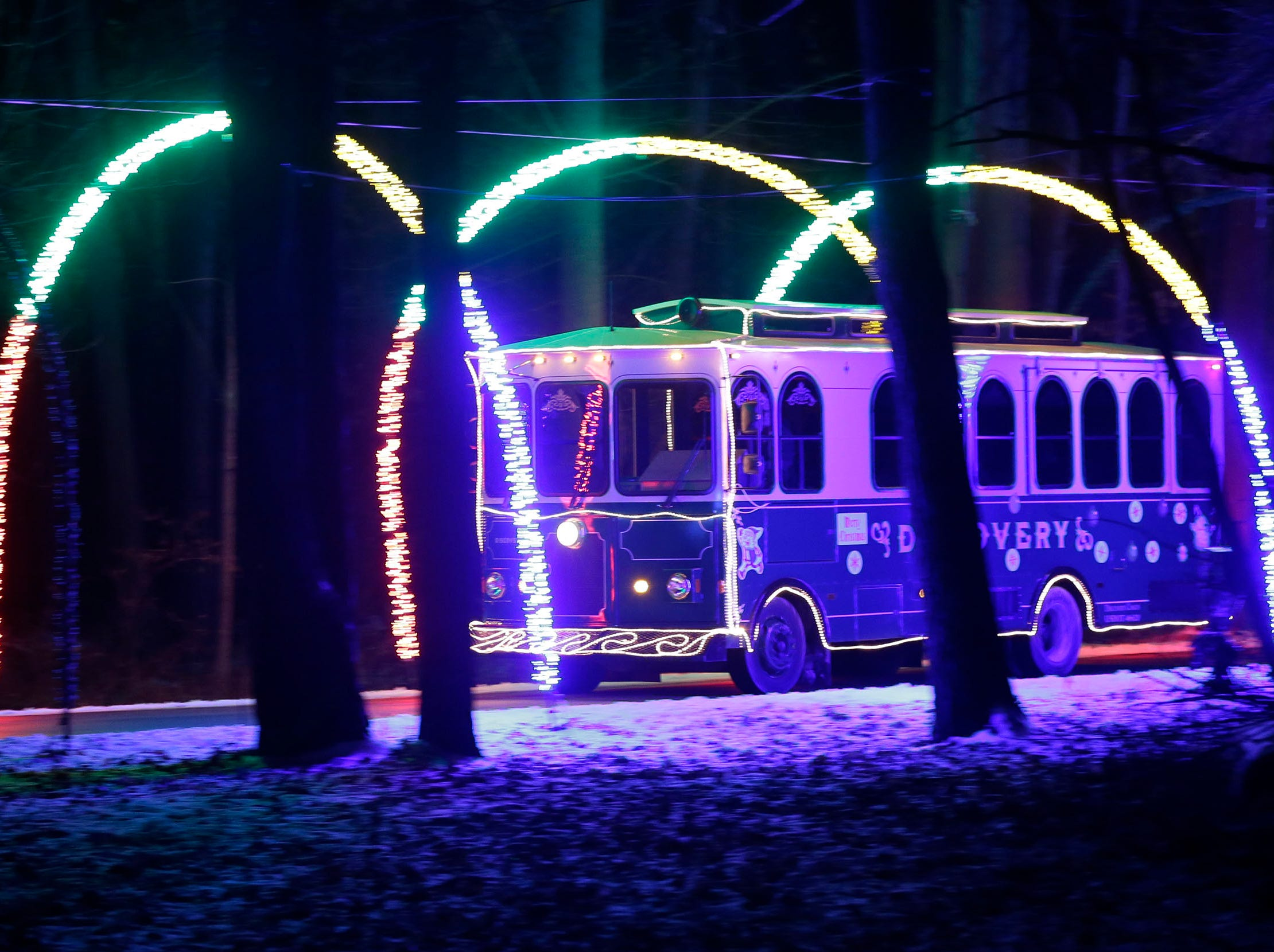 The Trolley goes through the tunnel of light at Making Spirits Bright at Evergreen Park, Friday, November 30, 2018, in Sheboygan, Wis.