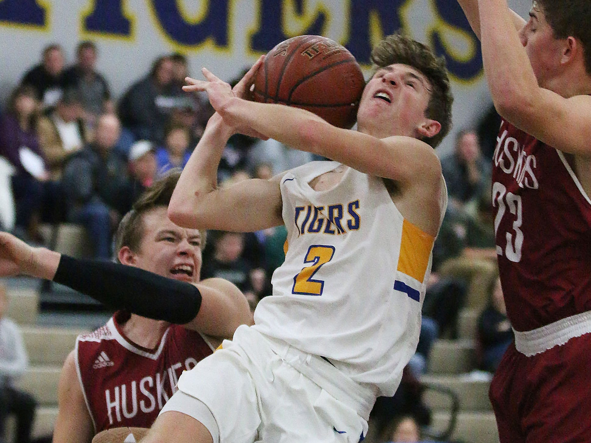 Howards Grove's Will Rautmann (2) struggles to aim the ball against New Holstein, Friday, November 30, 2018, in Howards Grove, Wis.