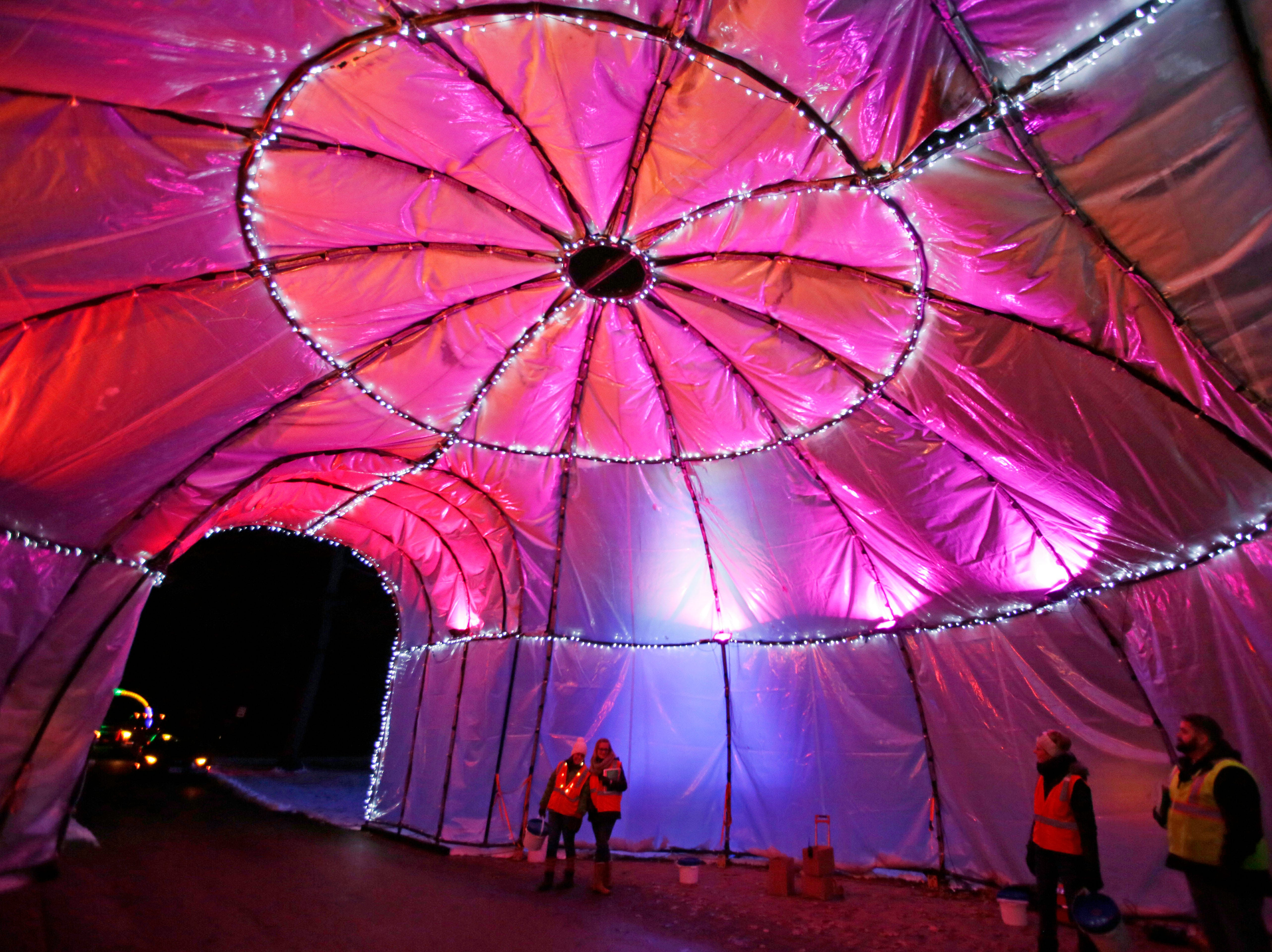 A big igloo serves as an exit point for cash donations at Making Spirits Bright at Evergreen Park, Friday, November 30, 2018, in Sheboygan, Wis.