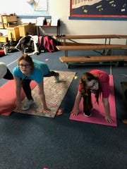 Elkhart Lake-Glenbeulah Middle School students practice yoga as part of Yoga Club.