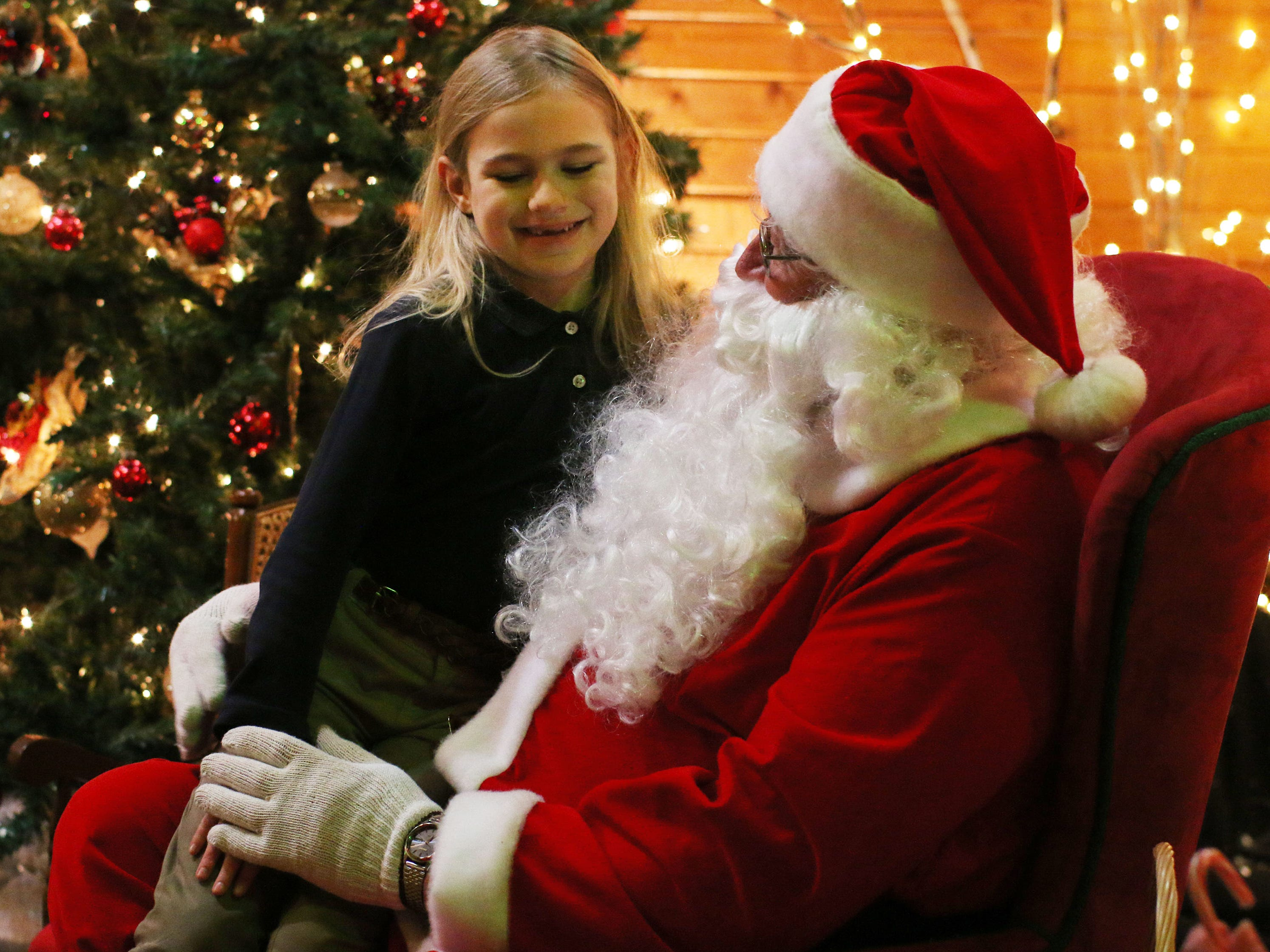 Cynthia Wagner, 7, gets in a gift request with Santa Claus at the Quarryview Center for Making Spirits Bright, Friday, November 30, 2018, in Sheboygan, Wis.