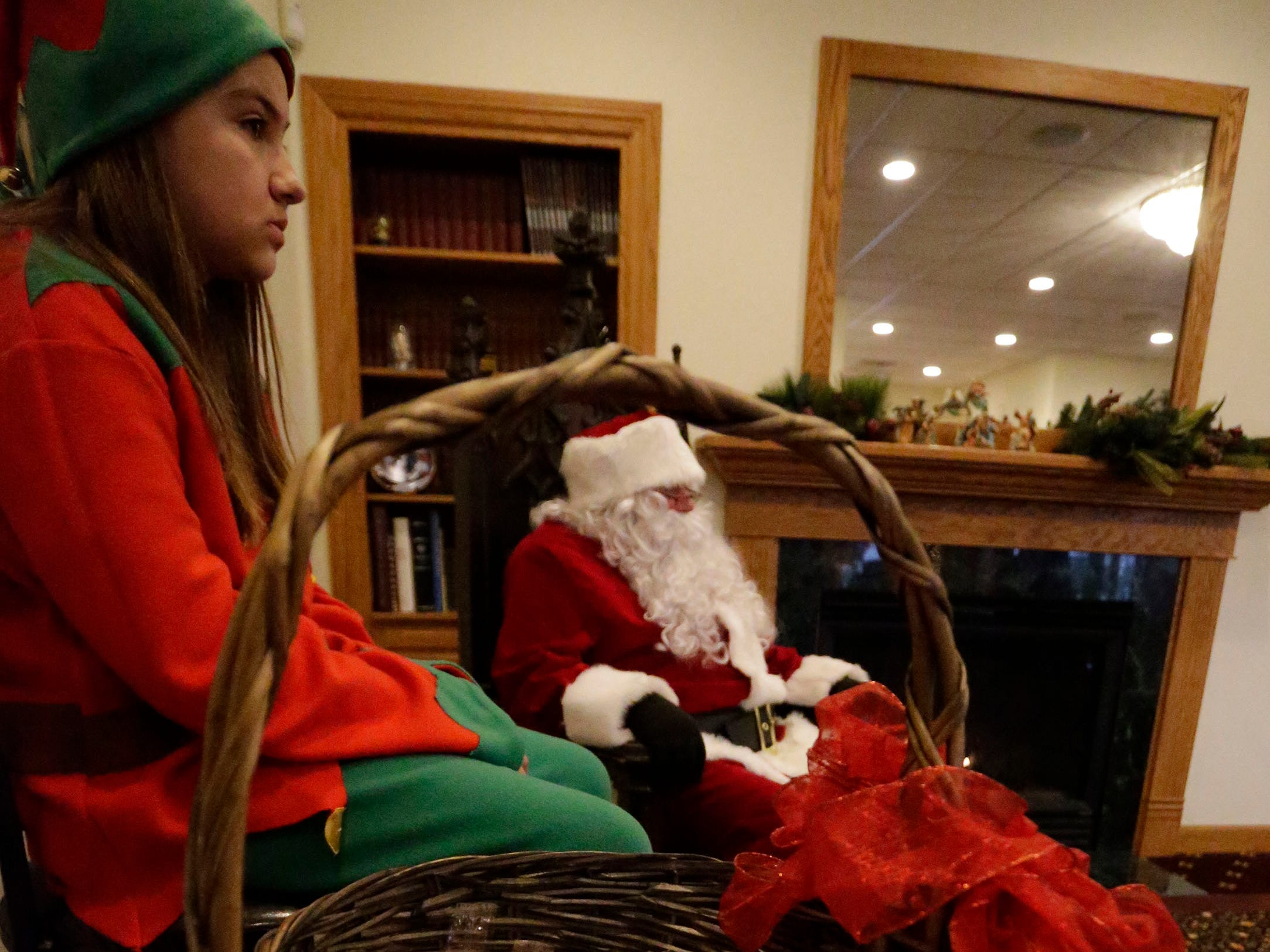 Santa awaits a child during Cookies with Santa at Zimmer Westview Funeral and Cremation Care Center Saturday, December 1, 2018, in Howards Grove, Wis.  The firm also plans to have Santa at Ballhorn Chapels on December 8, 2018.