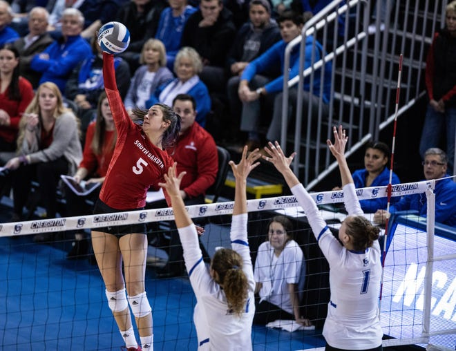 Jenna Wagemester goes for the spike on Friday night during the Coyotes' loss to Creighton in the opening round of the NCAA volleyball tournament at DJ Sokol Arena.