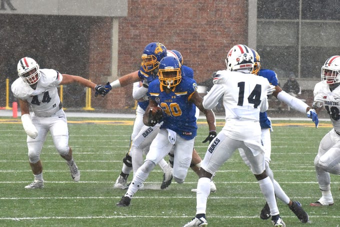 SDSU's Pierre Strong, Jr. (20) scores a touchdown during the FCS playoff game against Duquesne in Brookings, S.D., Saturday, Dec. 1, 2018.