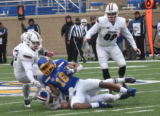 SDSU's Marshon Harris (18) gets tackled during the FCS playoff game against Duquesne in Brookings, S.D., Saturday, Dec. 1, 2018.
