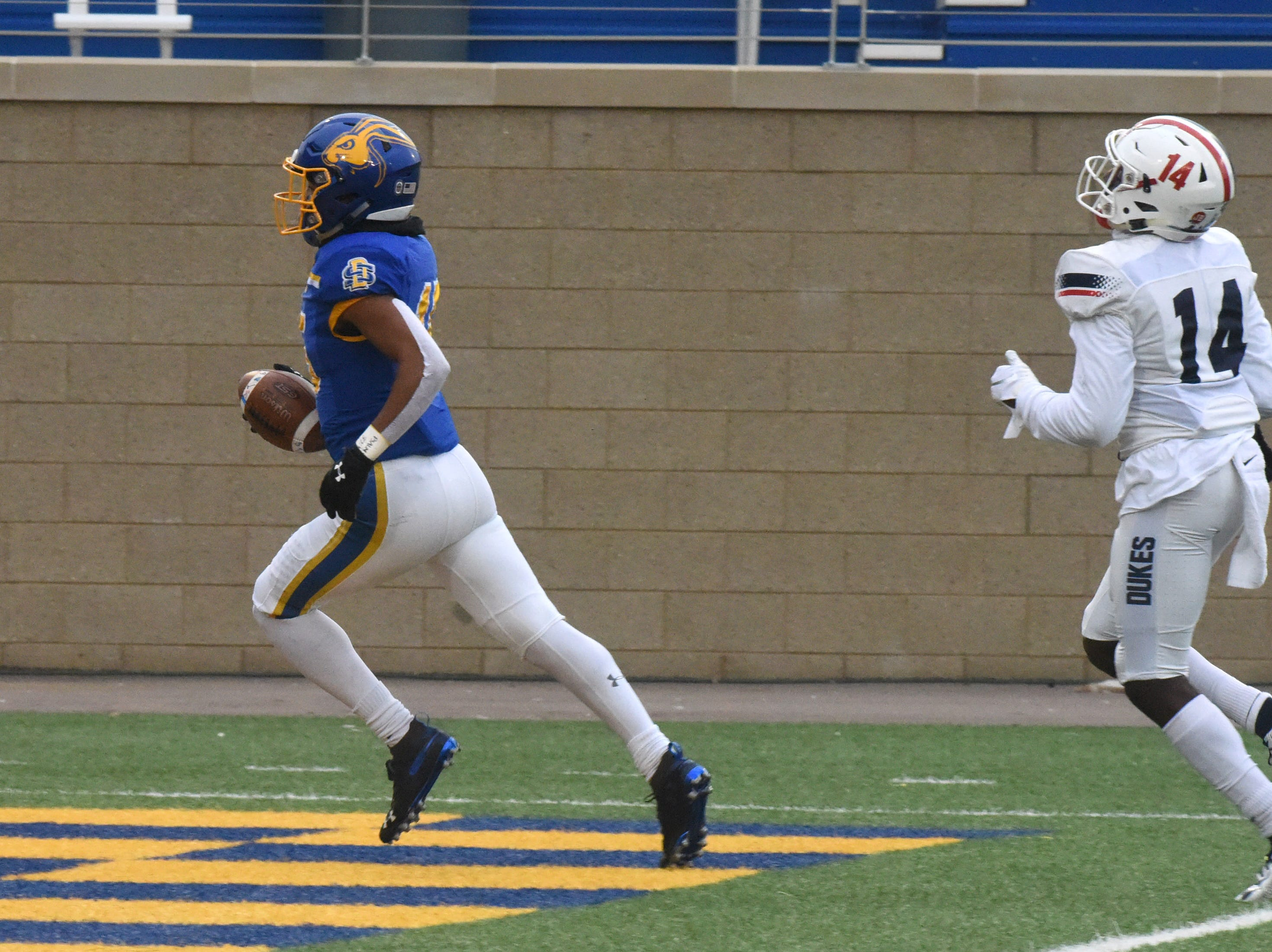 SDSU's Cade Johnson (15) scores a touchdown during the FCS playoff game against Duquesne in Brookings, S.D., Saturday, Dec. 1, 2018.