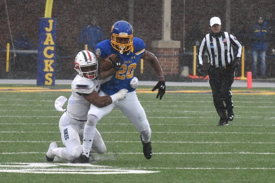 SDSU's Pierre Strong, Jr. (20) runs the ball during the FCS playoff game against Duquesne in Brookings, S.D., Saturday, Dec. 1, 2018.
