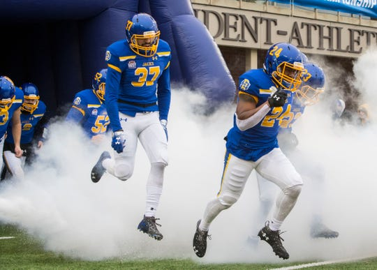 SDSU players run on the field before the FCS playoff game against Duquesne in Brookings, S.D., Saturday, Dec. 1, 2018.