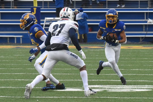 SDSU's Cade Johnson (15) runs the ball during the FCS playoff game against Duquesne in Brookings, S.D., Saturday, Dec. 1, 2018.