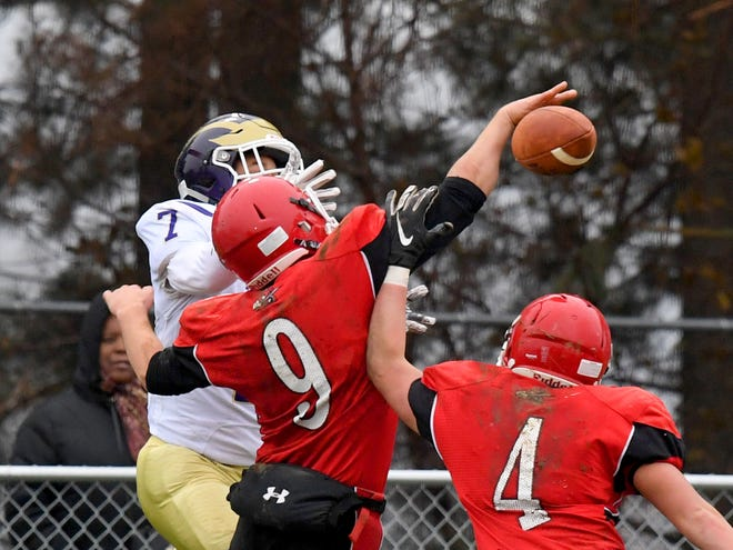 Riverheads' Elijah Dunlap (#9) breaks up a pass intended for Essex's Takeyo Day Jr. during a VHSL Class 1 state semifinal game played in Greenville on Saturday, Dec. 1, 2018.