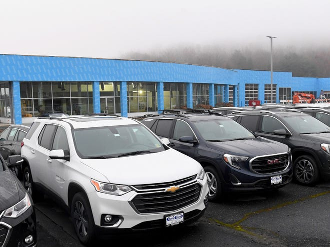 The building expansion at Charlie Obaugh Chevrolet Buick GMC is viewed behind vehicles for sale on their lot in Staunton on Saturday, Dec. 1, 2018.