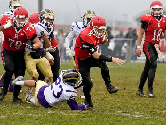 Riverheads' Zac Smiley has the ball as he slips out of a tackle attempt by Essex's William Clarke during a VHSL Class 1 state semifinal game played in Greenville on Saturday, Dec. 1, 2018.