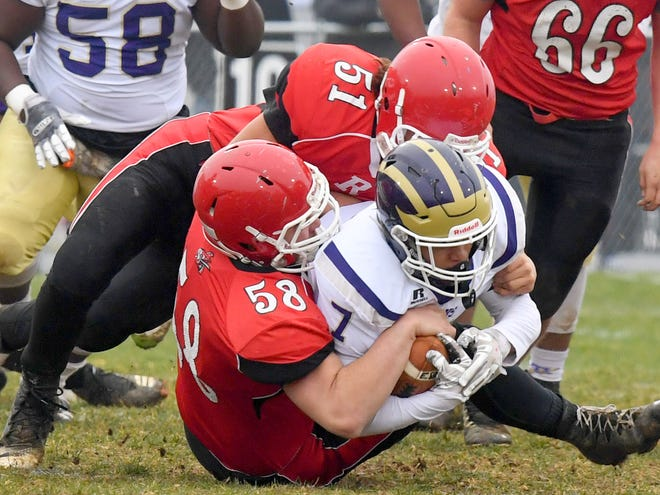 Riverheads' Davis Cogar (#58) and Ethan Hartless (#51) work together to tackle Essex's ballcarrier Takeyo Day Jr. during a VHSL Class 1 state semifinal game played in Greenville on Saturday, Dec. 1, 2018.