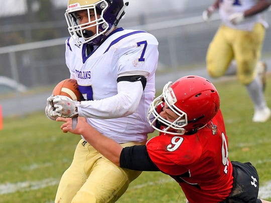 Riverheads' Elijah Dunlap tackles Essex's ballcarrier Takeyo Day Jr. during a VHSL Class 1 state semifinal game played in Greenville on Saturday, Dec. 1, 2018.