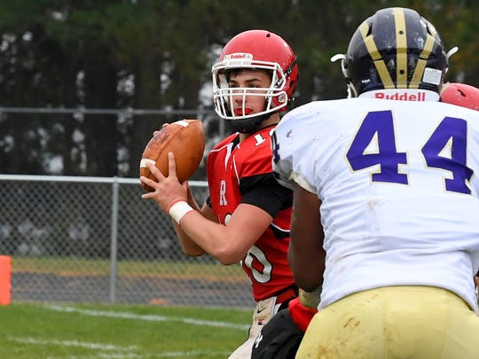 Riverheads' quarterback Justin McWhorter looks to pass during a VHSL Class 1 state semifinal game played in Greenville on Saturday, Dec. 1, 2018.