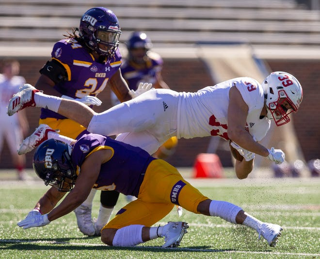 UMHB's Santos Villarreal III (6) sends SJU's Tommy Auger (39) flying during an NCAA Division III quarterfinal at Crusader Stadium on the UMHB campus in Belton, Texas, on Saturday, December 1. Michael Miller/Telegram