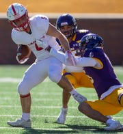 UMHB's Keith Gipson, right, spins SJU's Adam Essler (5) to the turf during an NCAA Division III quarterfinal at Crusader Stadium on the UMHB campus in Belton, Texas, on Saturday, December 1, 2018. Michael Miller/Telegram