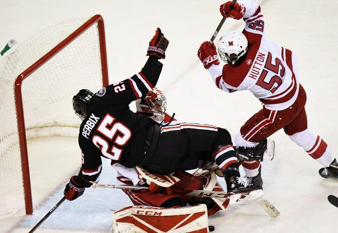 St. Cloud State freshman Nick Perbix crashes the net against University of Miami.