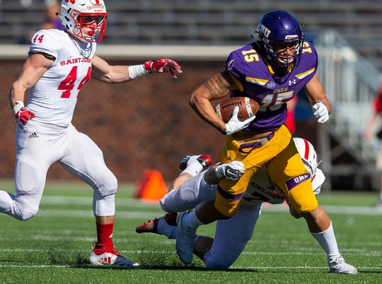 UMHB's Jonel Reed (15) runs after a catch against SJU's Sam Marshall (7) and Dom Nussmeier (44) during an NCAA Division III quarterfinal at Crusader Stadium on the UMHB campus in Belton, Texas, on Saturday, December 1, 2018. Michael Miller/Telegram