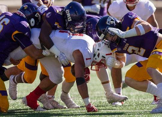 UMHB's Hunter Longcrier (46), Rozzell Barber-Harris (3) and Jefferson Fritz (2) combine to tackle SJU's Joey Eckhoff (1) during an NCAA Division III quarterfinal at Crusader Stadium on the UMHB campus in Belton, Texas, on Saturday, December 1, 2018. UMHB won 21-18. Michael Miller/Telegram