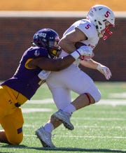 UMHB's De Jackson (40) drags down SJU's Adam Essler (5) during an NCAA Division III quarterfinal at Crusader Stadium on the UMHB campus in Belton, Texas, on Saturday, December 1, 2018. Michael Miller/Telegram